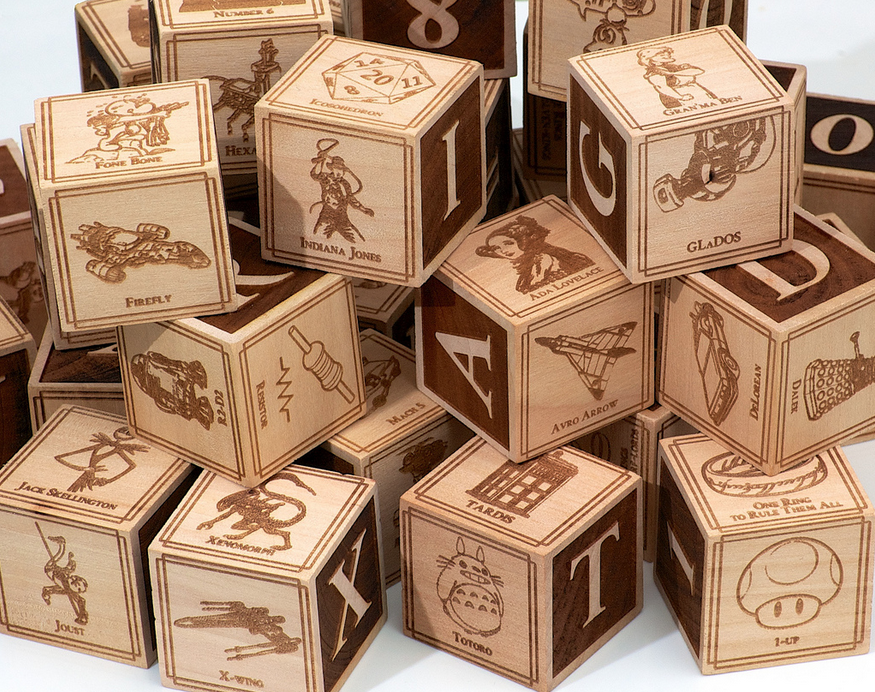 A collection of geeky alphabet building blocks by Jonathan Guberman